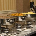 breakfast buffet setup with sausage, potatoes and scrambled eggs